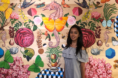 Girl Standing in front of pattern background
